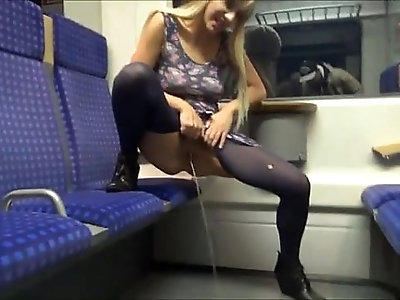 Blonde babe peeing in the train On xPee