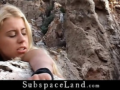 Busty amateur blonde bound by a stone and fucked in doggie