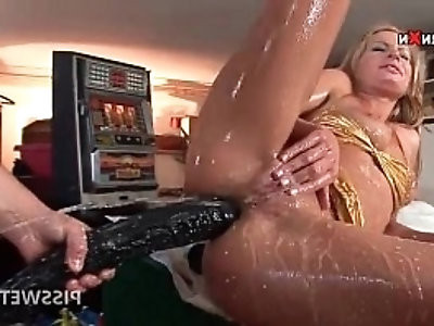 Wet slut slurps hot piss out of horny cock with a sex toy