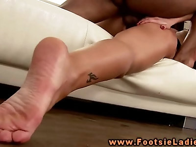 Foot babe uses feet and pussy on this lucky guy
