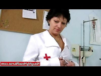 Juicy Mom in nurse uniform stretching furry twat