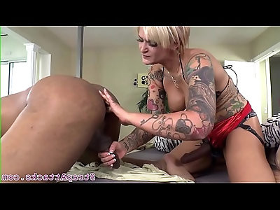 Busty dominatrix pegging her subs asshole